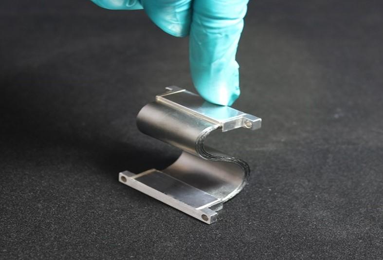 Pyrolytic graphite thermal strap - TAI